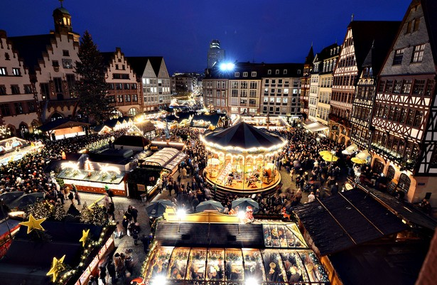 Christmas Markets Open Across Germany...FRANKFURT/MAIN, GERMANY - NOVEMBER 26:  Visitors walk through the Christmas market at Roemerberg square on its opening day on November 26, 2014 in Frankfurt, Germany. Christmas markets, which traditionally sell mulled wine, stollen cake, Christmas tree ornaments and other crafts and are an essential part of German Christmas tradition, open across the country this week.  (Photo by Thomas Lohnes/Getty Images) Christmas Markets Lifestyle – The Best Christmas Markets FRANKFURT