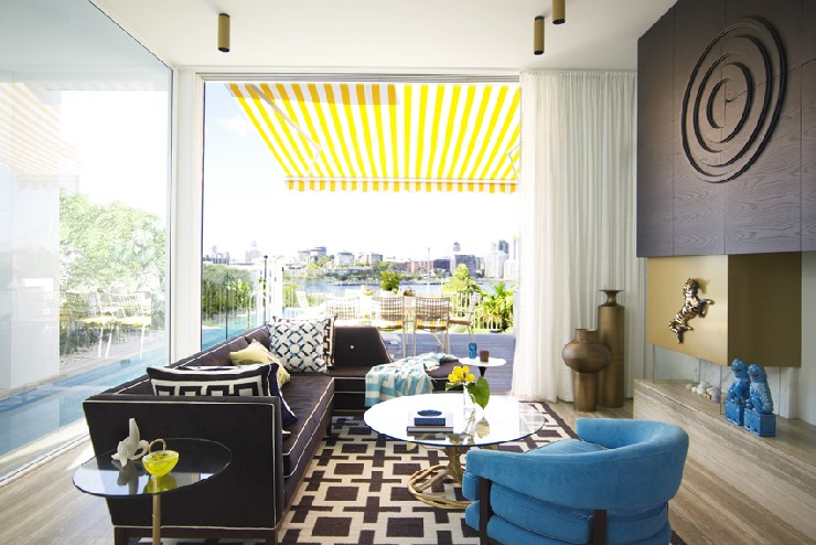by Greg Natale Greg Natale 25 Best Interior Design Projects by Greg Natale Love the pops of turquoise and yellow alongside the black and gold anchors in this living room by Greg Natale