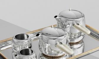 Marc Newson Designs Silver Tea Set Made With Mammoth-Ivory Handles Marc Newson tea set Georg Jensen dezeen sq 335x201